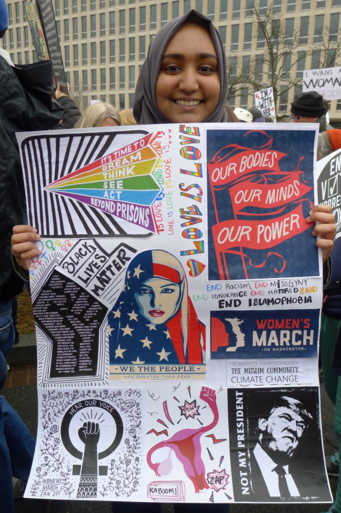 Muslim Woman Holding Poster, LS Photo, cropped